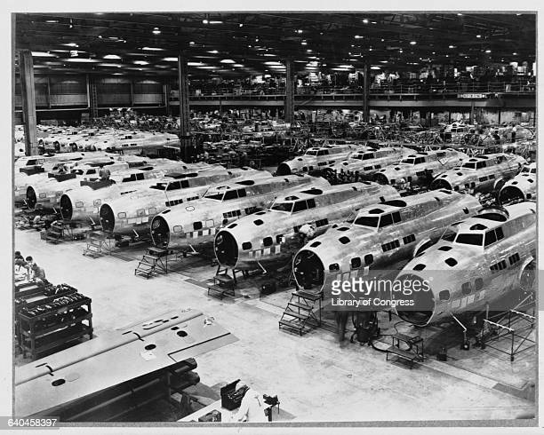 Rows of B17 Flying Fortress heavy bombers are under production at a Boeing plant in Seattle Washington 19421945