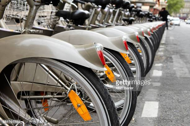 Rows of back wheels of Parisien hire cycles