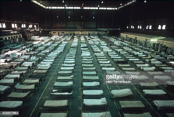 Rows of beds for homeless men at an armory in Brooklyn New York New York January 5 1987