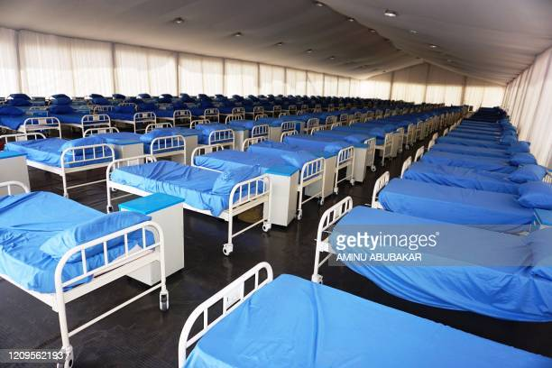 Rows of beds inside the male section at a COVID-19 coronavirus isolation centre at the Sani Abacha stadium in Kano, Nigeria, on April 7, 2020. - The...