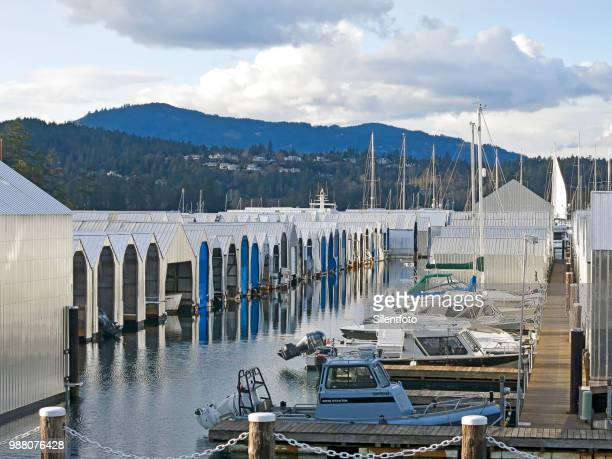 Rows of Boats & Steel Boathouses With Background Landscape, Vancouver Island, BC
