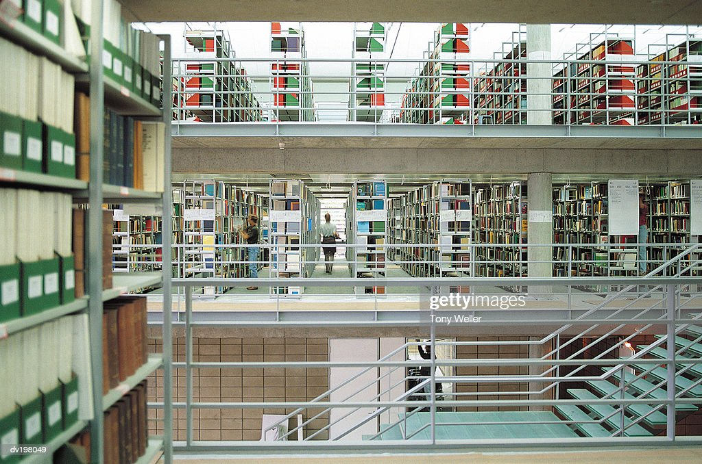 Rows of bookshelves in library : Stock Photo