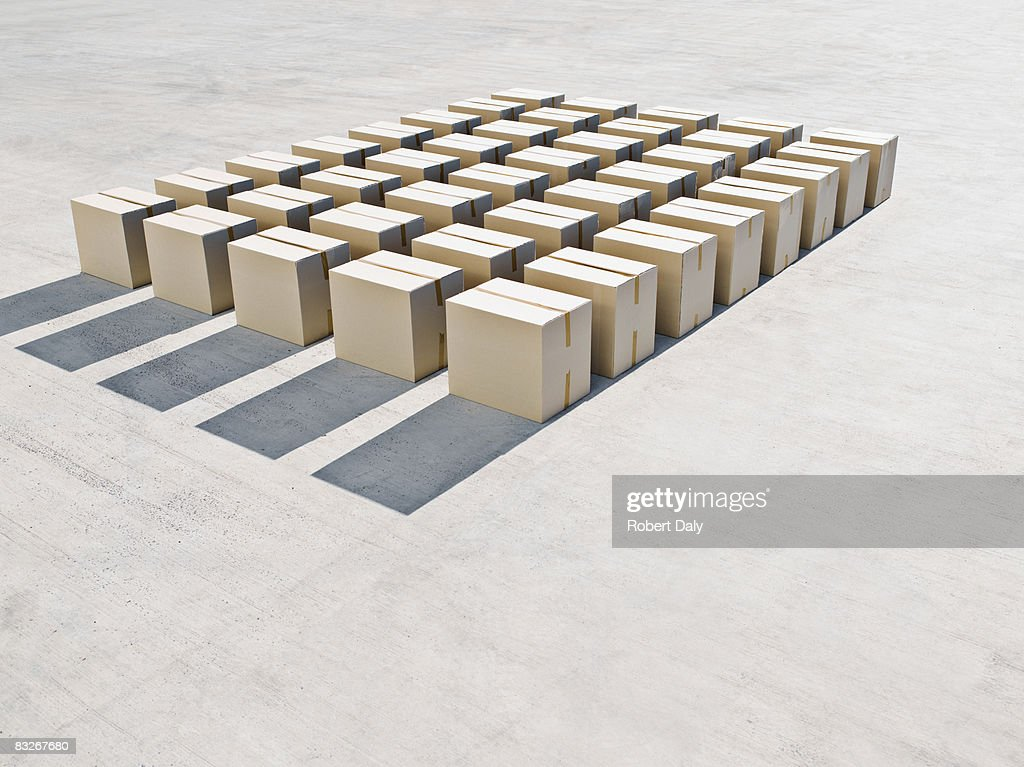 Rows of boxes on sidewalk : Stock Photo