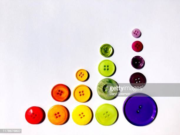 rows of buttons sorted by color - color coded stock pictures, royalty-free photos & images