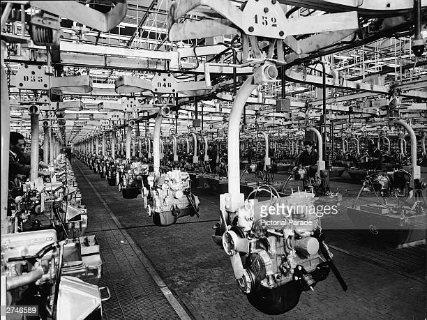 Rows of car engines at the Fiat Mirafiori plant undergo tests on an assembly line Turin Italy 1950
