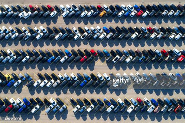 rows of cars in a large parking lot, aerial view - full stock pictures, royalty-free photos & images