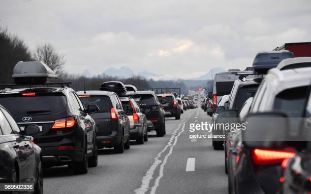 Rows of cars move slowly ahead on the A8 motorway near Holzkirchen Germany 23 December 2017 Holiday traffic is jamming the streets across Bavaria at...