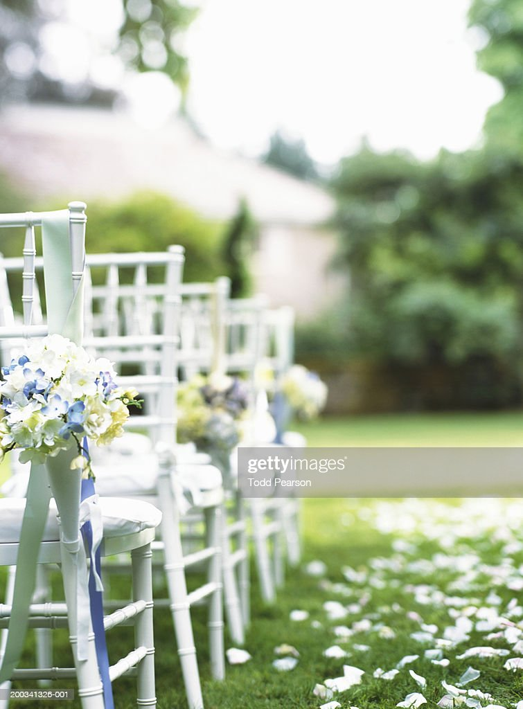 Rows of chairs beside grassy aisle (focus on chair in foreground)  Stock Photo & Rows Of Chairs Beside Grassy Aisle Stock Photo | Getty Images