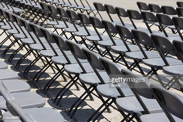 rows of chairs in the town square - lutavia stock pictures, royalty-free photos & images