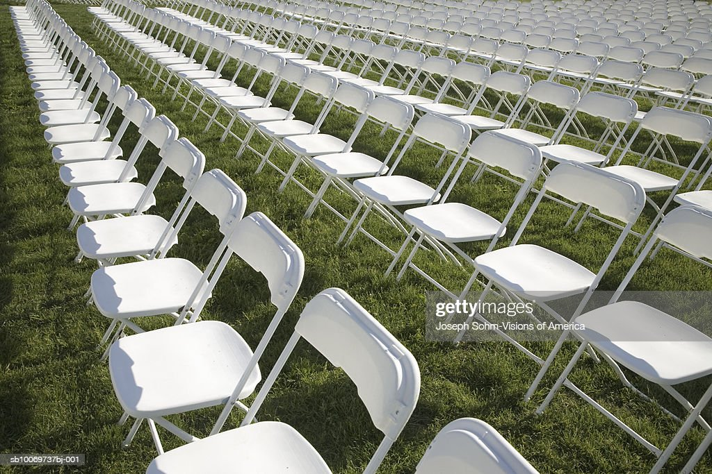 Rows of chairs on grass  Stock Photo & Rows Of Chairs On Grass Stock Photo | Getty Images