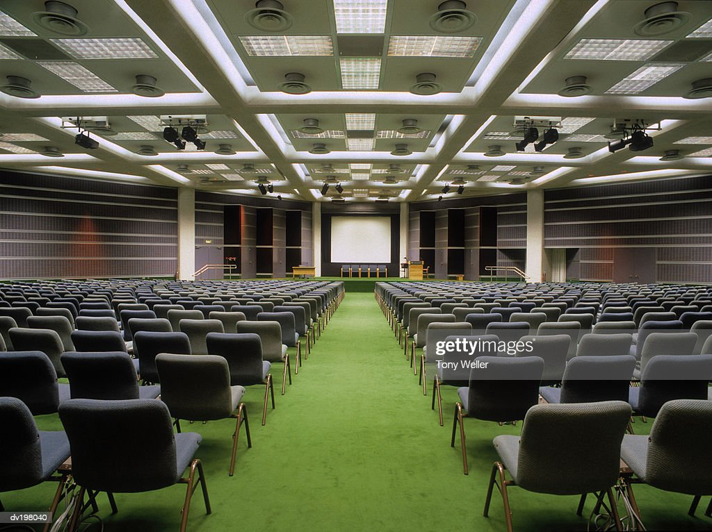 Rows of chairs set up for presentation in hall : Stock Photo