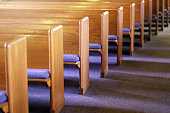 Rows of Church Pews in an Empty Church Sanctuary