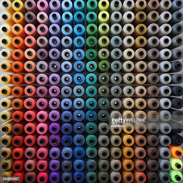 rows of colorful sewing thread - thread stock pictures, royalty-free photos & images