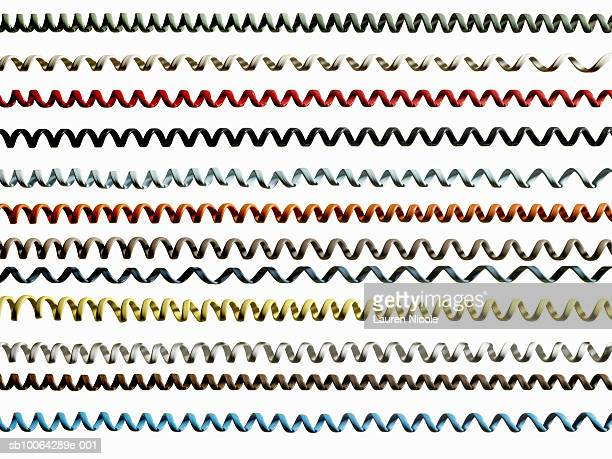 Rows of coloured phone cords on white background (full frame)