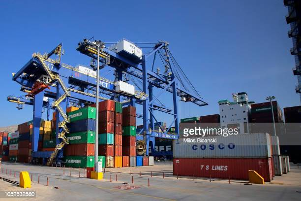 Rows of coloured shipping containers from COSCO Pacific Ltd, A.P. Moeller-Maersk A/S, CMA CGM SA, Yang Ming Marine Transport Corp, and Evergreen...