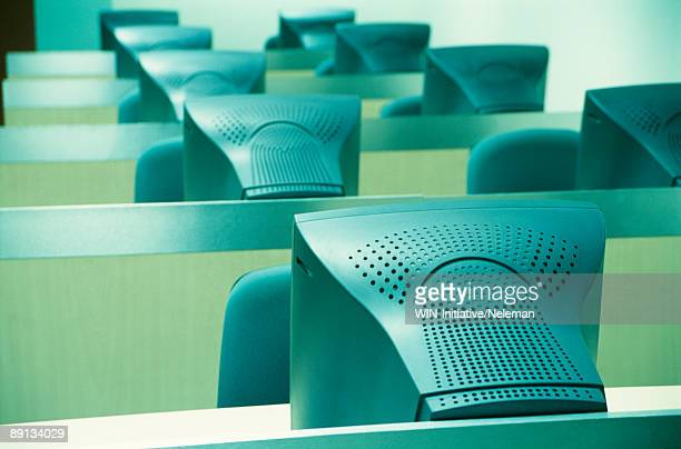 Rows of computers in a classroom, India