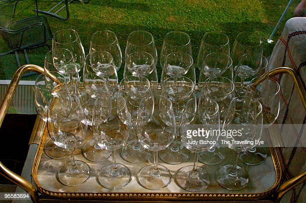 Rows of crystal glasses, ready for garden party