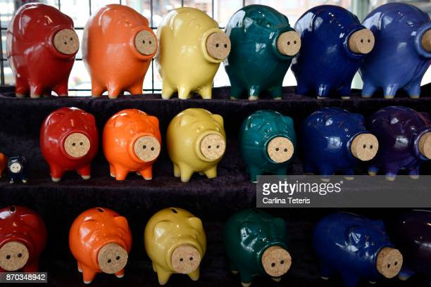 Rows of different coloured piggy banks