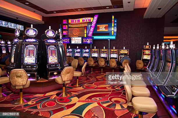 Rows of electronic slot machines inside of Genting's new Resorts World New York casino at Aqueduct Race Track in Jamaica section of Queens in New...