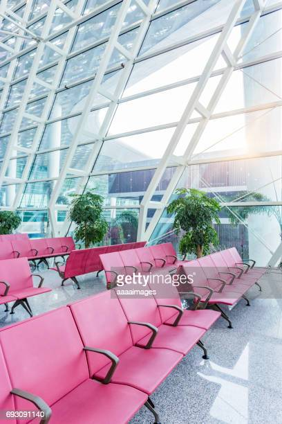 Rows of empty chairs at airport in Shanghai