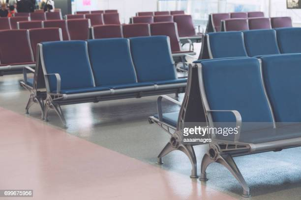 Rows of empty chairs at airport