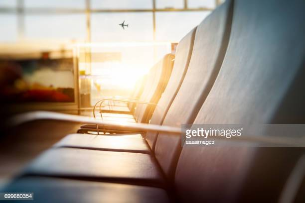 Rows of empty chairs at airport,defocused view