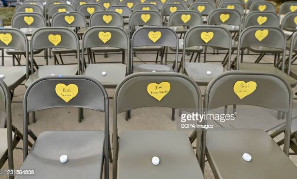 Rows of empty chairs with heart symbols during the event. A memorial and vigil for victims of Covid19 was held outside of the Luzerne County...