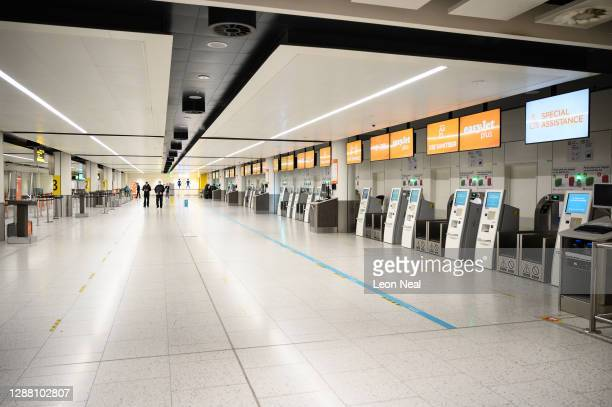 Rows of empty EasyJet check-in desks are seen in the North Terminal at Gatwick Airport on November 27, 2020 in London, England. The airport will...