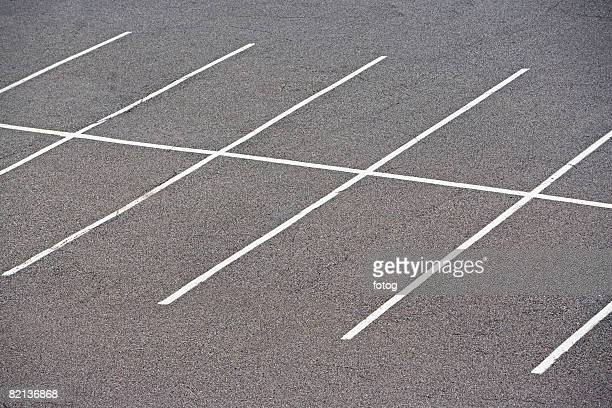 Rows of empty parking spaces