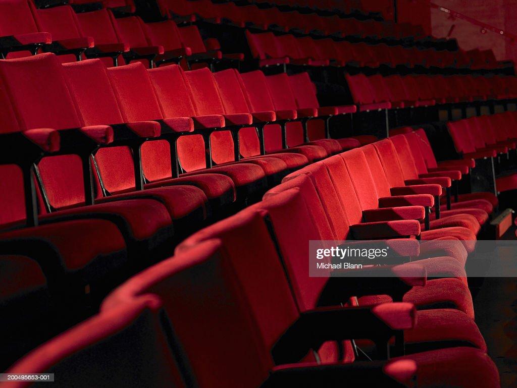 Rows of empty red cinema seats : Stock Photo