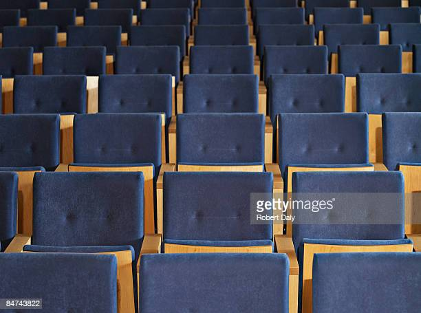 rows of empty seats in conference room - auditorium stock pictures, royalty-free photos & images
