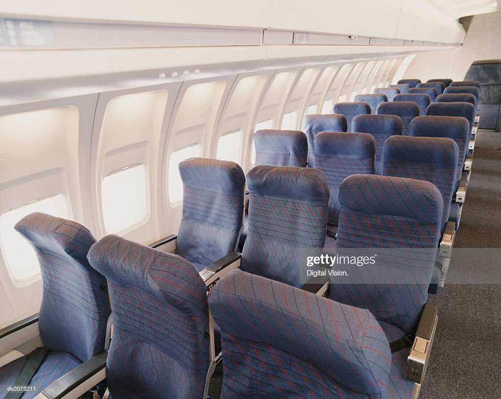 Rows of Empty Seats on a Plane : Stock Photo