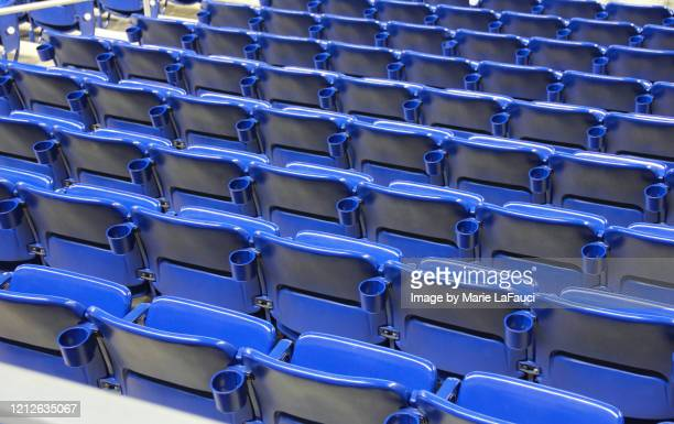 rows of empty stadium seats with cup holders - fauci stock pictures, royalty-free photos & images