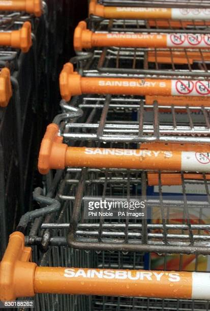 Rows of empty trolleys at a Sainsbury's Superstore in Liverpool perhaps indicate a slump in popularity for the firm of supermarket giant's Sainsbury...