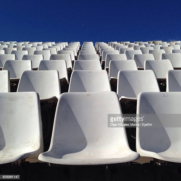 Rows of Empty White Chairs