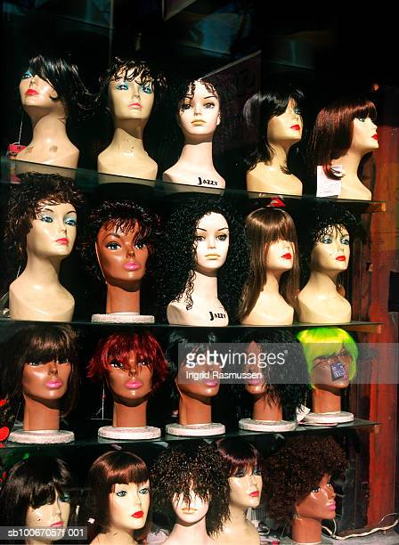 Rows of female mannequin heads wearing wigs