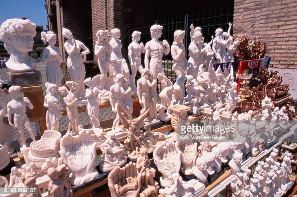 rows of figurines for sale - eric van den brulle stock pictures, royalty-free photos & images