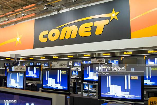 Rows of flat screen televisions in Comet electrical goods store, England, UK