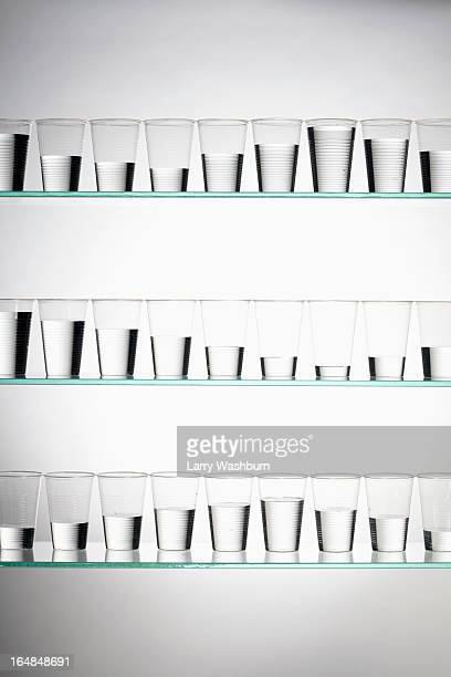 Rows of glasses filled with varying amounts of water