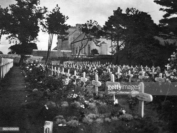 Rows of graves marked by crosses in a military cemetery during World War 1, France, 1918.