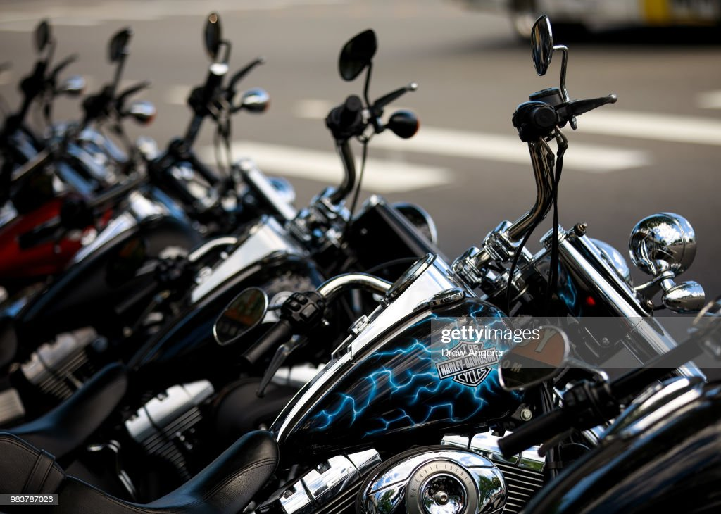 Rows of Harley-Davidson motorcycle sit for sale outside of