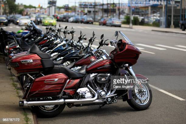 Rows of HarleyDavidson motorcycle sit for sale outside of the HarleyDavidson of New York City showroom store June 25 2018 in the Queens borough of...
