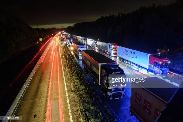 Rows of heavy goods vehicles and cargo lorries are seen queued along the M20 motorway as part of the Operation Stack traffic control plan, on...