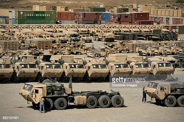 rows of heavy vehicles and supplies at camp warrior, afghanistan. - mine resistant ambush protected stock pictures, royalty-free photos & images