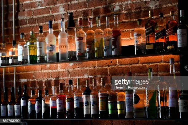 DENVER CO OCTOBER 24 Rows of high quality liquor is on display at the new bar called SneekEazy on October 24 2017 in Denver Colorado SneekEazy with a...