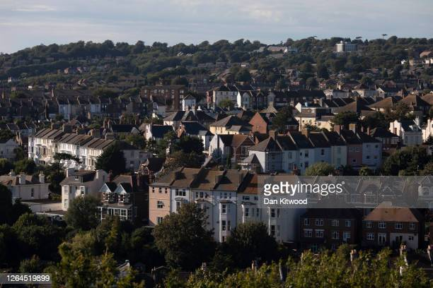 Rows of houses on August 05, 2020 in Hastings, England. The UK's housing market has slowly reopened after months of pandemic-related restrictions...
