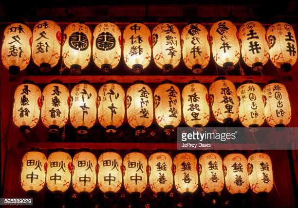 Rows of illuminated prayer lanterns at night