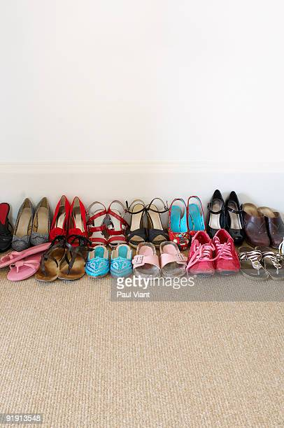 rows of ladies shoes on floor