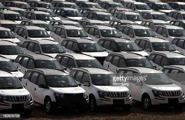 Rows of Mahindra Mahindra Ltd XUV 500 sport utility vehicles are parked in a stock yard at the company's factory in Chakan Maharashtra India on...