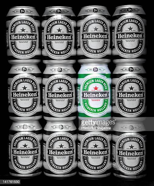 Rows of monochrome Heineken beer cans stacked one one top of the other with one can in full colour taken on October 15 2008